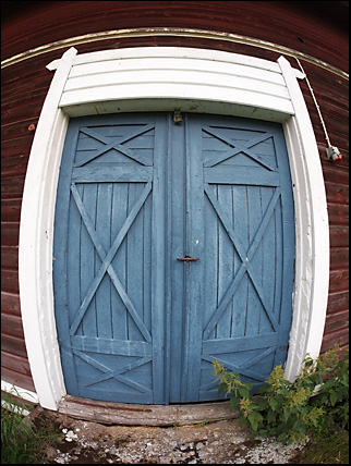 blue door into a cowshed