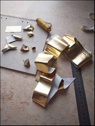spillbit av guldlamé